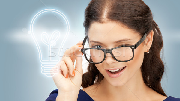 happy and smiling woman in specs Stock photo © dolgachov