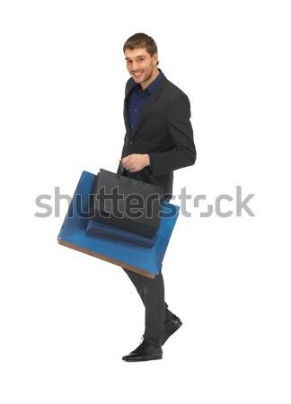 ストックフォト: ハンサムな男 · スーツ · ショッピングバッグ · 画像 · 男 · 幸せ