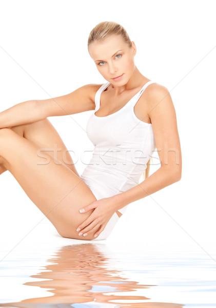 beautiful woman in cotton undrewear on white sand Stock photo © dolgachov