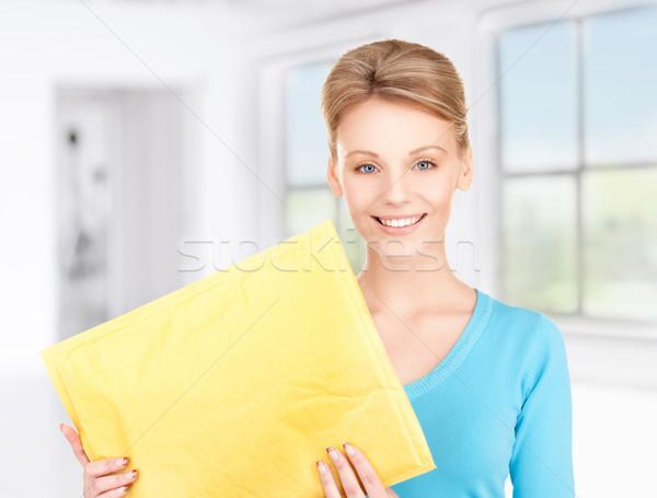 businesswoman with parcel Stock photo © dolgachov