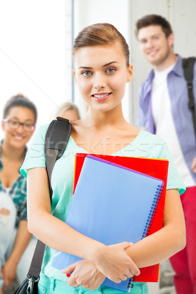 student girl with school bag and notebooks Stock photo © dolgachov