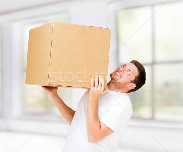 man carrying carton heavy box Stock photo © dolgachov