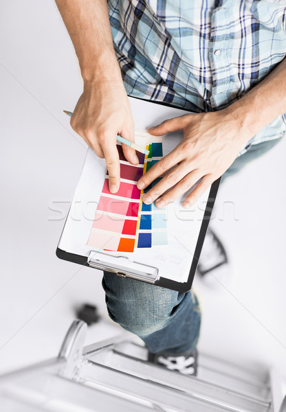 man with color samples for selection Stock photo © dolgachov