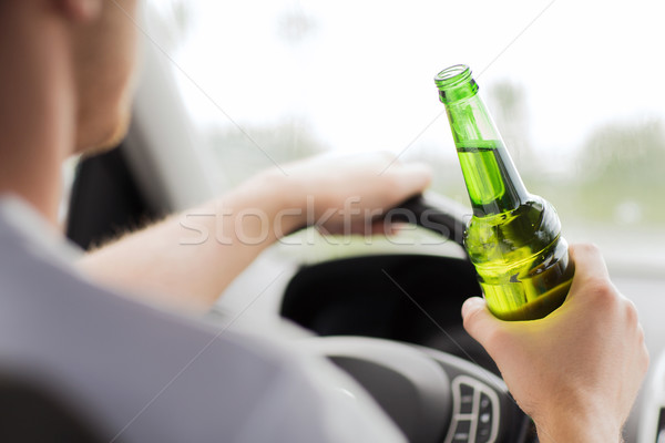 man drinking alcohol while driving the car Stock photo © dolgachov