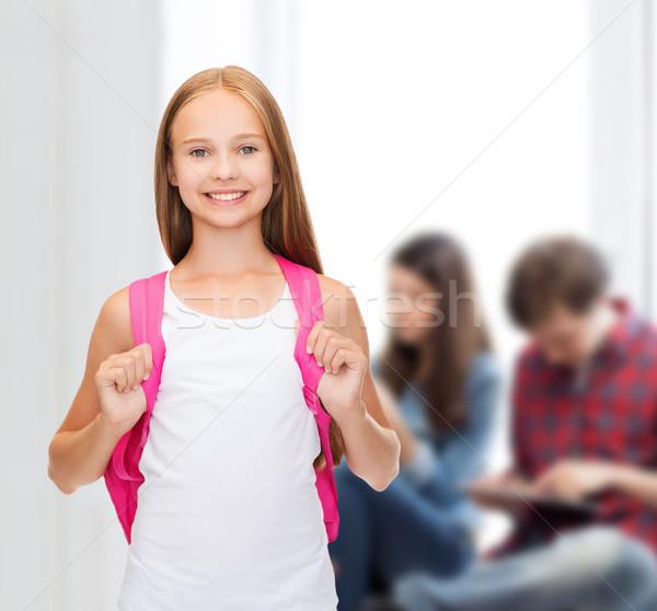 Uśmiechnięty biały zbiornika górę edukacji Zdjęcia stock © dolgachov