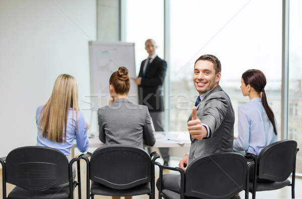businessman with team showing thumbs up in office Stock photo © dolgachov