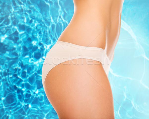 woman in cotton underwear showing slimming concept Stock photo © dolgachov