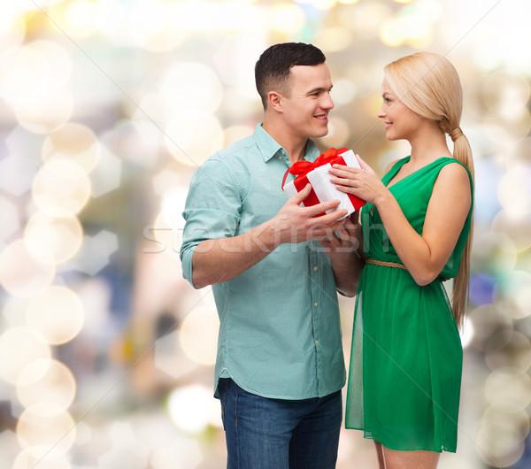 smiling couple with gift box Stock photo © dolgachov