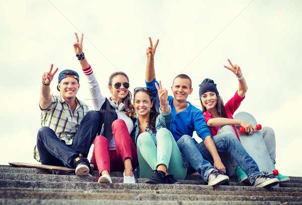 group of teenagers showing finger five Stock photo © dolgachov
