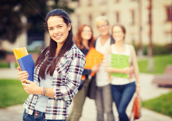 teenage girl with folders and mates on the back Stock photo © dolgachov