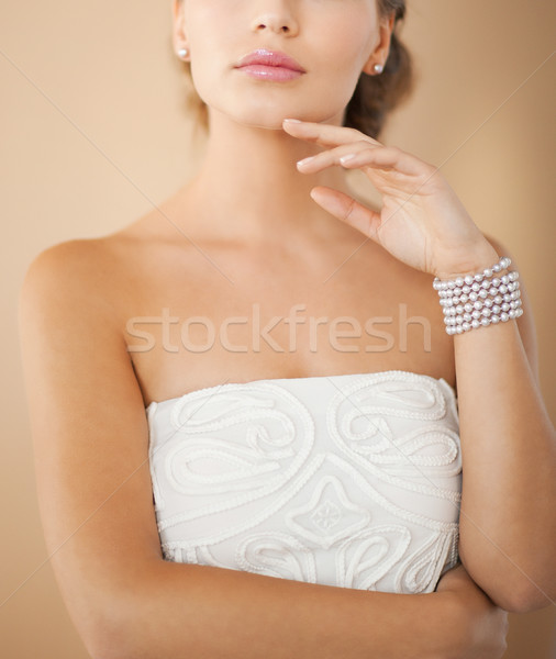 woman with pearl earrings and bracelet Stock photo © dolgachov