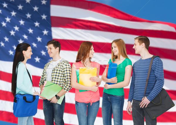 Grupo sonriendo estudiantes pie educación personas Foto stock © dolgachov