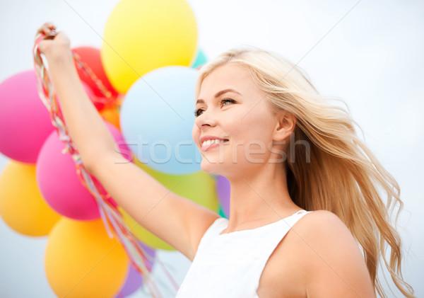 Nő színes léggömbök kívül nyár ünnepek Stock fotó © dolgachov