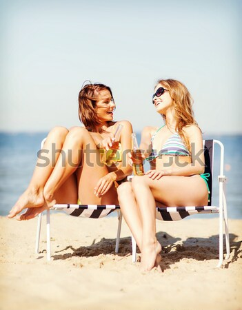 smiling young woman sunbathing in lounge on beach Stock photo © dolgachov