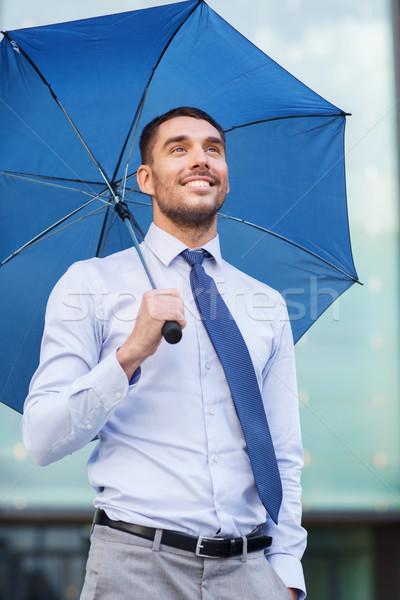 Genç gülen işadamı şemsiye açık havada iş Stok fotoğraf © dolgachov
