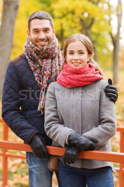 smiling couple hugging on bridge in autumn park Stock photo © dolgachov