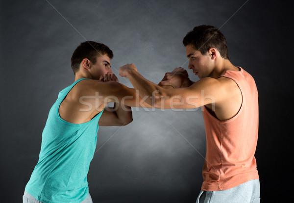 Fiatal férfiak bírkózás sport verseny erő emberek Stock fotó © dolgachov