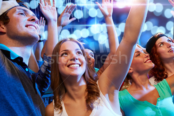 smiling friends at concert in club Stock photo © dolgachov