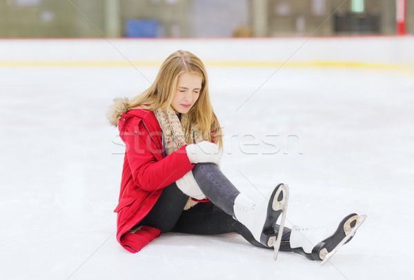 young woman fell down on skating rink Stock photo © dolgachov