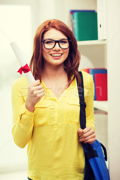 smiling female student with laptop bag and diploma Stock photo © dolgachov