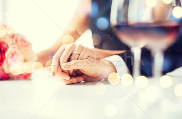 engaged couple with wine glasses Stock photo © dolgachov