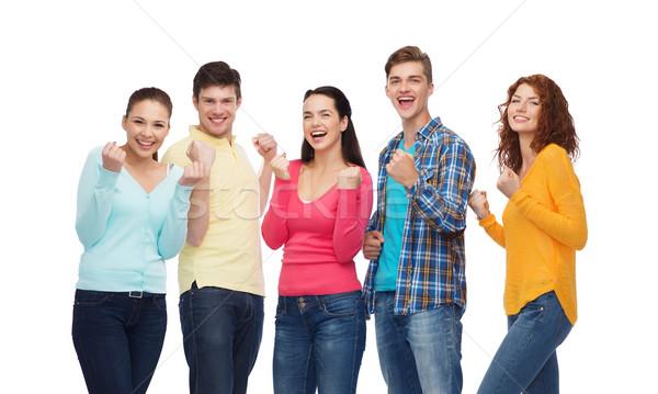 группа улыбаясь подростков триумф жест Сток-фото © dolgachov