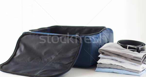 Közelkép üzleti út táska ruházat üzleti út csomagok Stock fotó © dolgachov