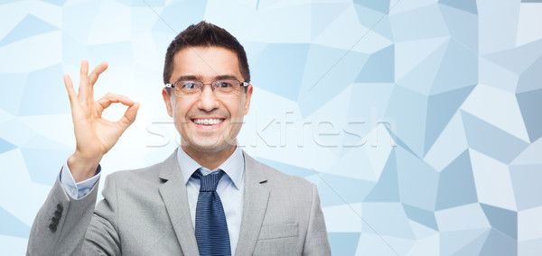 happy smiling businessman in eyeglasses and suit Stock photo © dolgachov