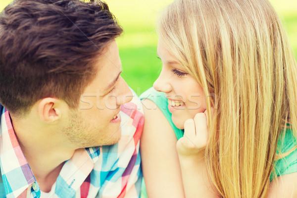 Souriant couple regarder autre parc vacances Photo stock © dolgachov