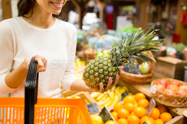 close up of woman with pineapple in grocery market Stock photo © dolgachov