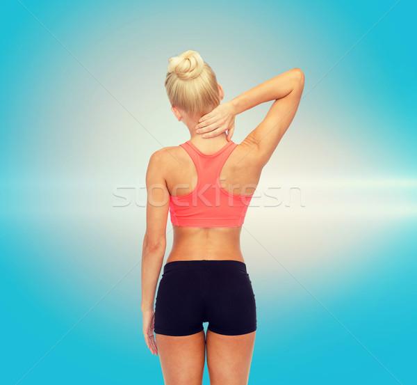 sporty woman touching her neck Stock photo © dolgachov