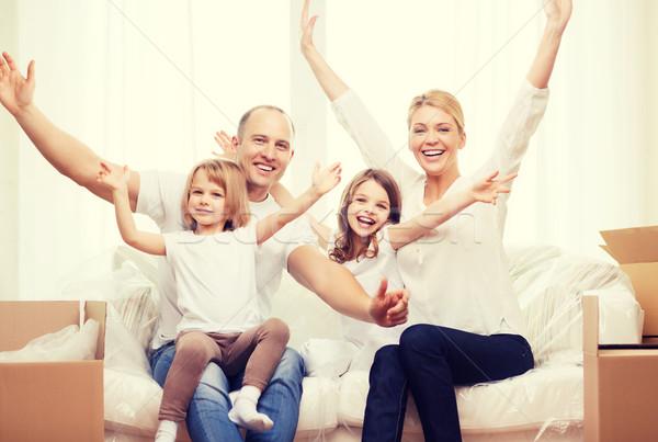 Stok fotoğraf: Gülen · ebeveyn · iki · yeni · ev · aile
