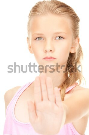 Lány mutat stoptábla fényes kép kéz Stock fotó © dolgachov