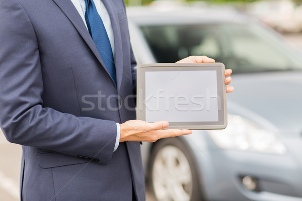 close up of young man with tablet pc and car Stock photo © dolgachov