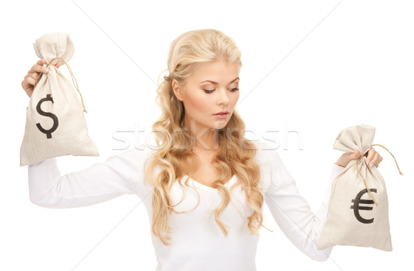 woman with euro and dollar bags Stock photo © dolgachov
