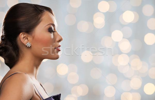 Mulher diamante brinco férias luzes pessoas Foto stock © dolgachov