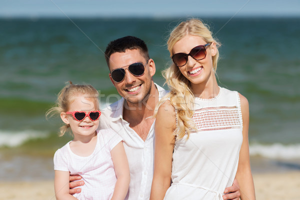 happy family in sunglasses on summer beach Stock photo © dolgachov