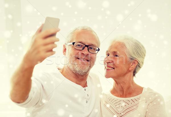 Boldog idős pár okostelefon otthon család technológia Stock fotó © dolgachov