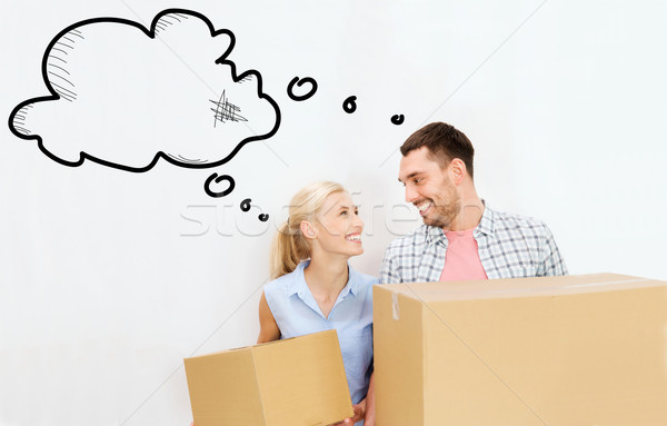 couple with delivery boxes moving to new home Stock photo © dolgachov