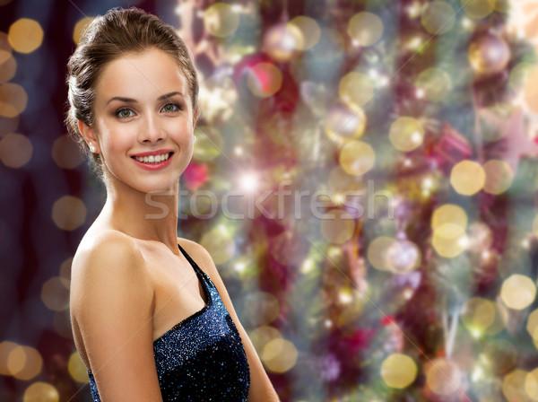 Heureux femme boucles d'oreilles Noël lumières Photo stock © dolgachov