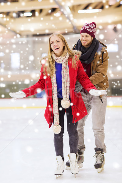 happy couple on skating rink Stock photo © dolgachov