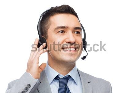 Sorridente empresário fone pessoas de negócios tecnologia serviço Foto stock © dolgachov