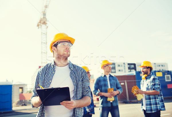 group of builders in hardhats outdoors Stock photo © dolgachov
