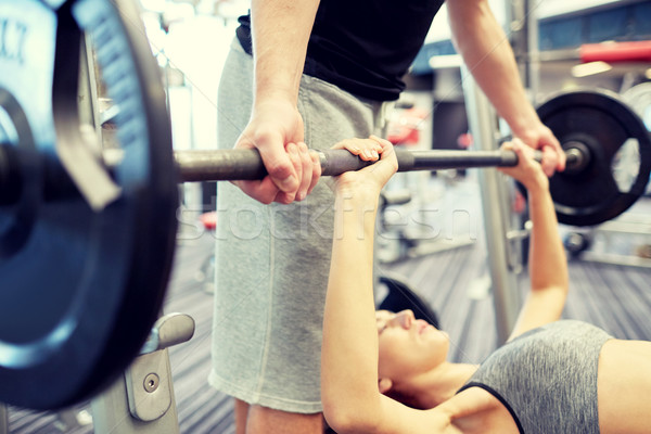 close up of couple with barbell exercising in gym Stock photo © dolgachov