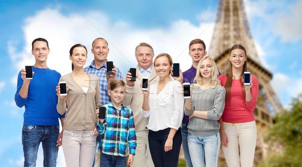 Grupy ludzi Wieża Eiffla rodziny technologii podróży Zdjęcia stock © dolgachov