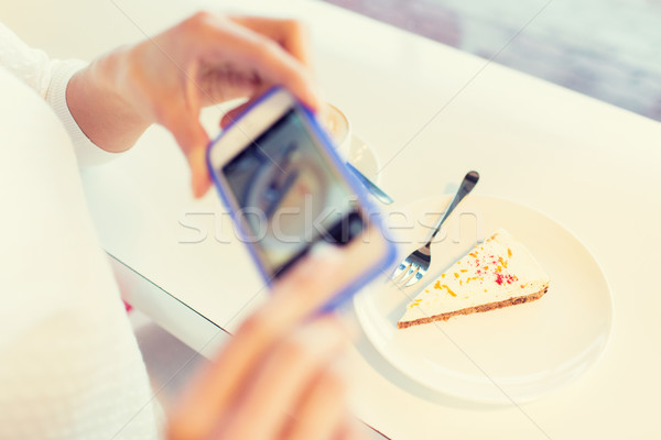 woman hands with smartphone taking food picture Stock photo © dolgachov