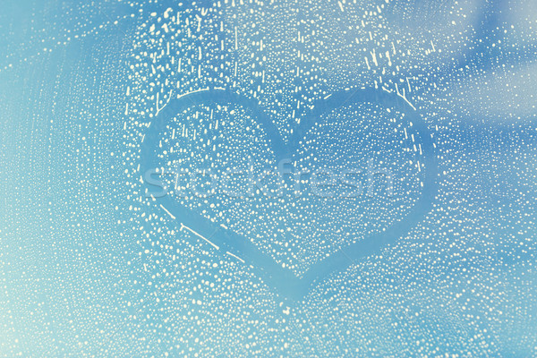 close up of heart shape on soapy window glass Stock photo © dolgachov