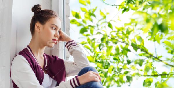 Szomorú csinos tinilány ül ablakpárkány emberek Stock fotó © dolgachov