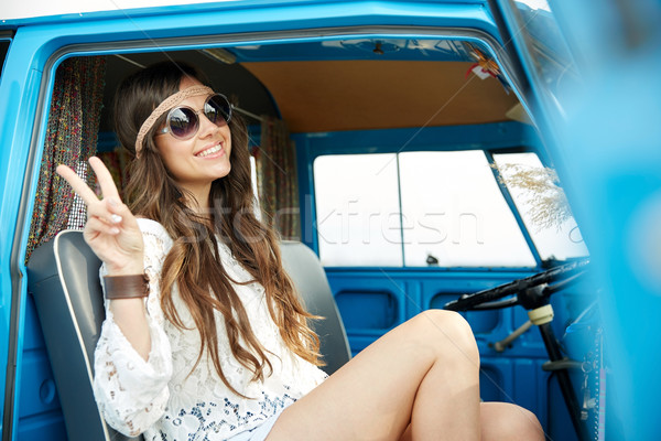 happy hippie woman showing peace in minivan car Stock photo © dolgachov