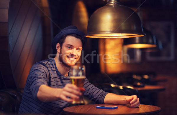 happy man drinking beer at bar or pub Stock photo © dolgachov